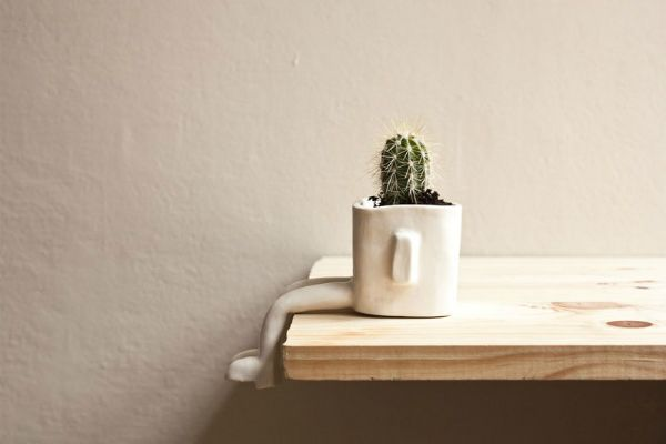 http://www.trendhunter.com/trends/sitting-plant-pot