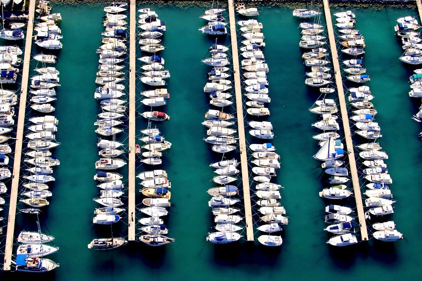 White sailing boats and yachts in port