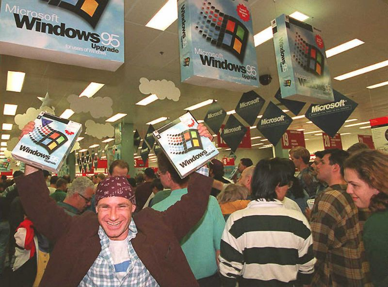 Mikol Furneaux(L) waves two packages of Windows 95