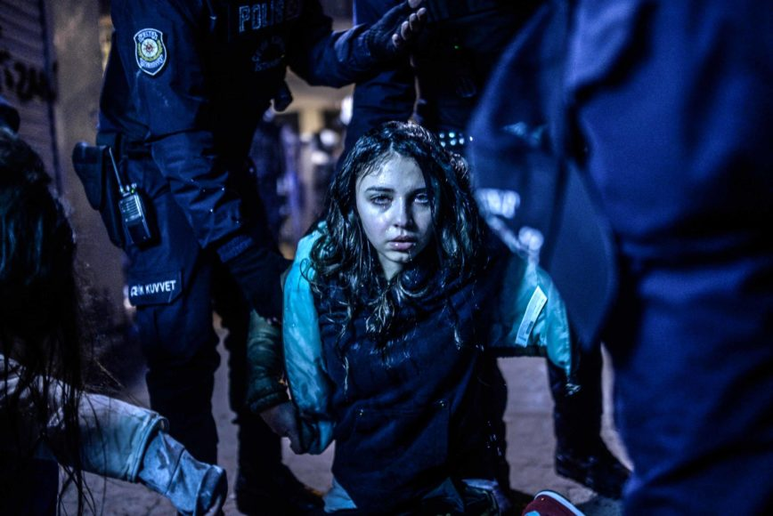 A young girl is pictured after she was wounded during clashes between riot-police and prostestors after the funeral of Berkin Elvan, the 15-year-old boy who died from injuries suffered during last year's anti-government protests, in Istanbul on March 12, 2014. Riot police fired tear gas and water cannon at protestors in the capital Ankara, while in Istbanbul, crowds shouting anti-government slogans lit a huge fire as they made their way to a cemetery for the burial of Berkin Elvan. AFP PHOTO/BULENT KILIC