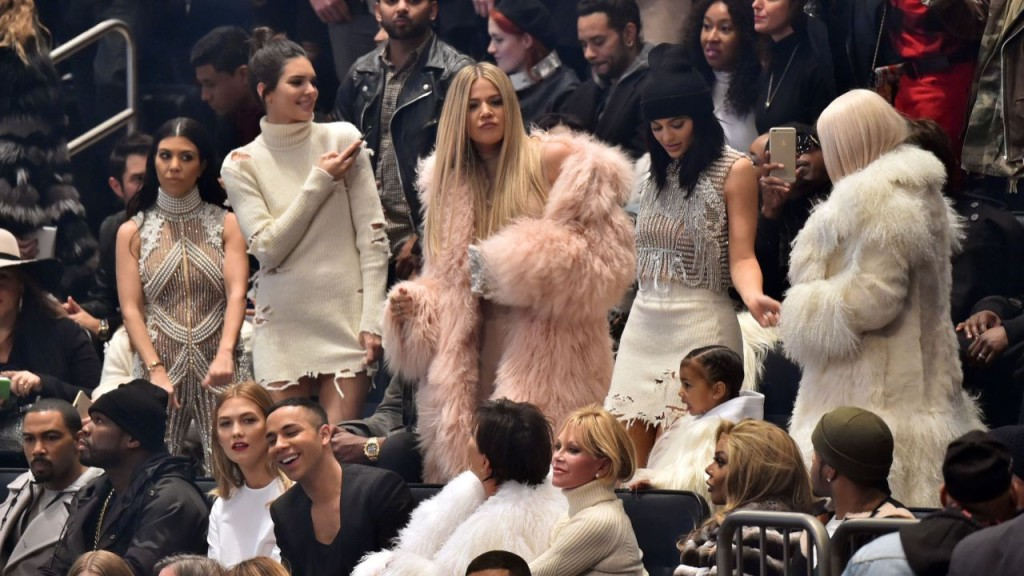 Mandatory Credit: Photo by Andrew H. Walker/WWD/REX/Shutterstock (5585909p) Kourtney Kardashian, Kendall Jenner, Khloe Kardashian, Kylie Jenner and Kim Kardashian, Karlie Kloss, Olivier Rousteing and Kris Jenner in the front row Yeezy show, Runway, Fall Winter 2016, New York Fashion Week, America - 11 Feb 2016