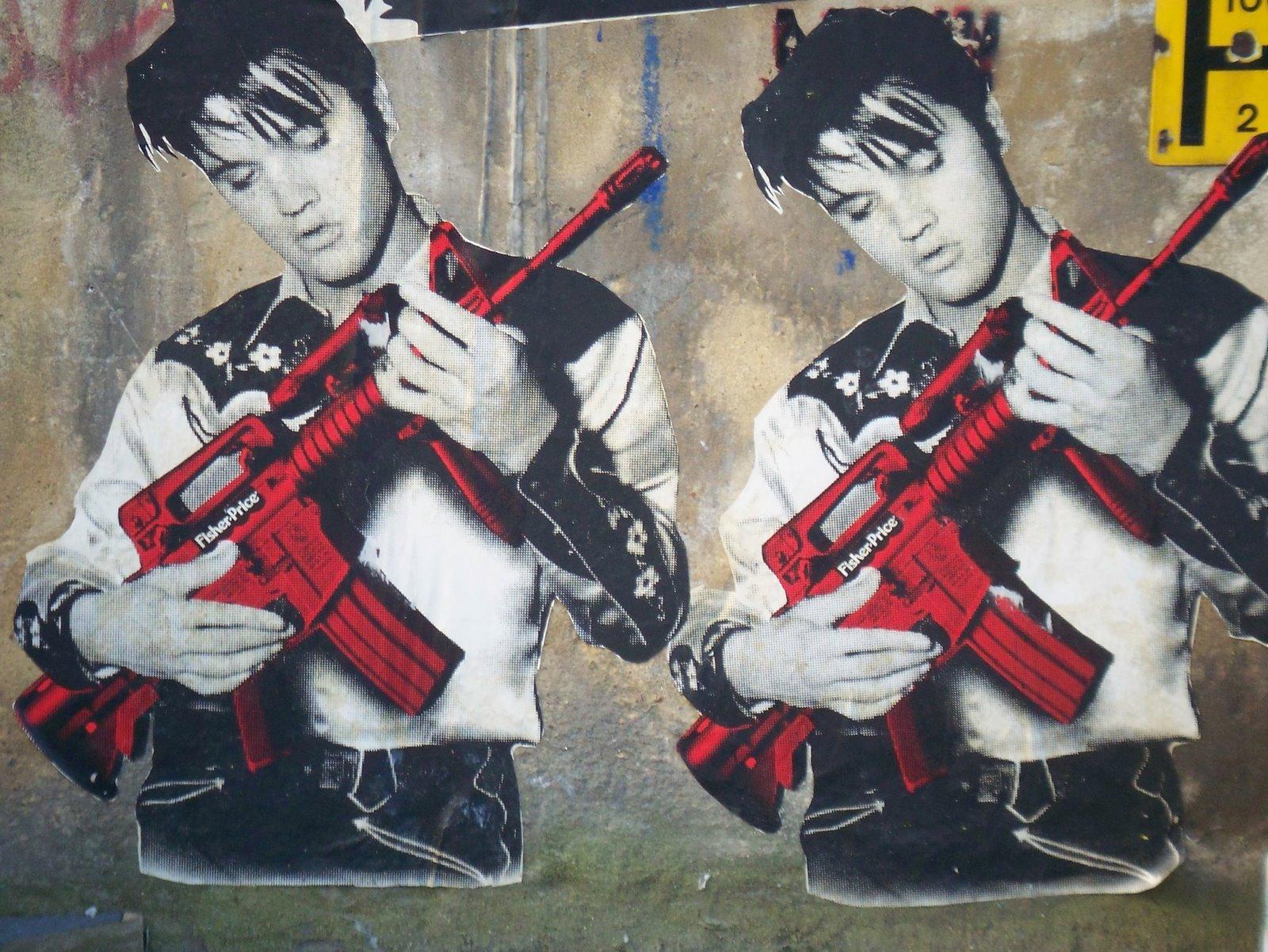 Wizerunek Elvisa Presleya z karabinem w rękach