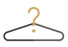 Czarny wieszak na ubrania z żółtym znakiem zapytania