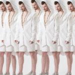 Mężczyzni ubrani w białę bluzy i krótkie białe spodnie