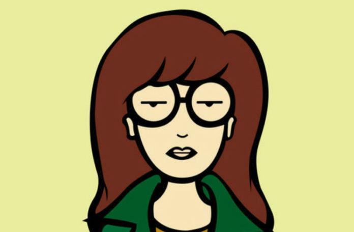 Grafika przedstawiająca brązowowłosą dziewczynę w okularach, zielonej marynarce i musztardowej koszulce