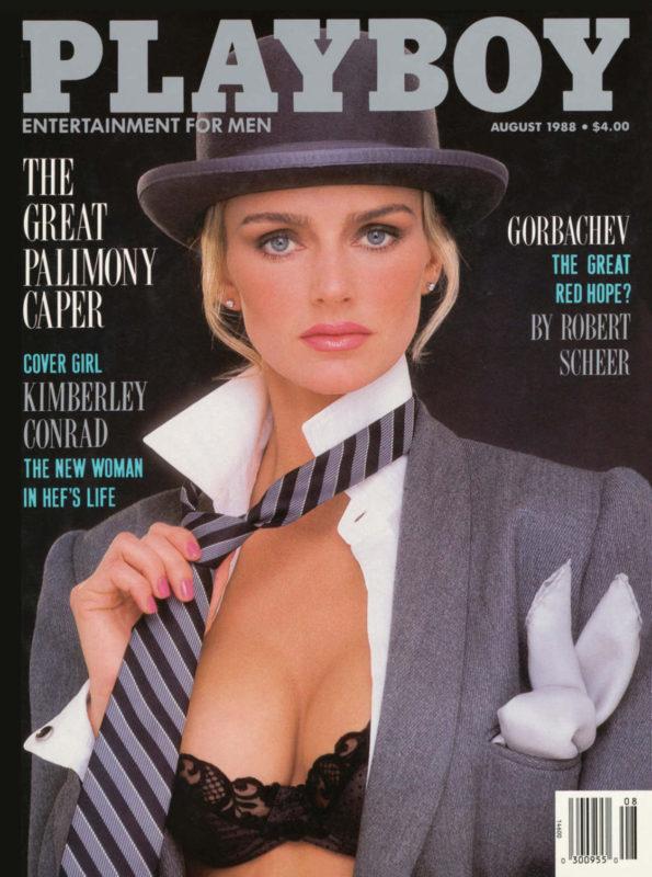 na zdjęciu jest modelka w kapeluszu i krawacie i marynarce