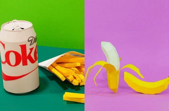 Papierowa puszka coli, a obok papierowy banan