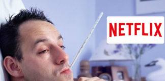 Mężczyzna z termometrem w ustach