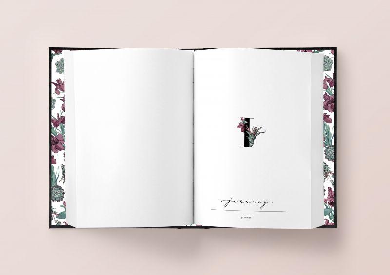 Kalendarz otwarty dwie biale strony na prawej stronie widac jedynke owinieta czerwonym kwiatem oraz napis september rozowe tlo