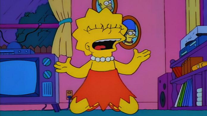 Żółtoskóra bohaterka serialu ubrana w pomarańczowa sukienke