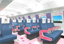 Wnętrze pociągu z grantowo-różowymi fotelami