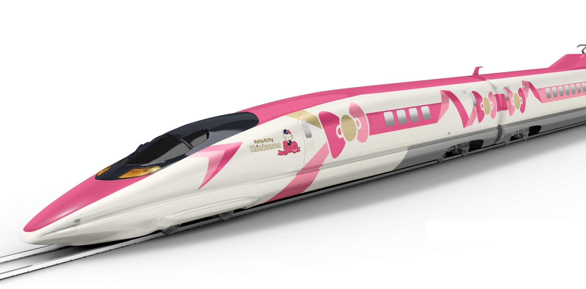 Biało różowy pociąg z namalowaną różową kokardą po boku na białym tle.