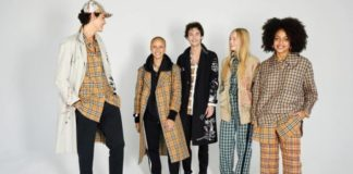Ludzie prezentujący akcesoria i ubrania burberry