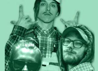 Trzech mężczyzn na zielonym tle