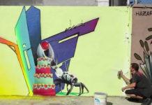 Mężczyzna malujący mural