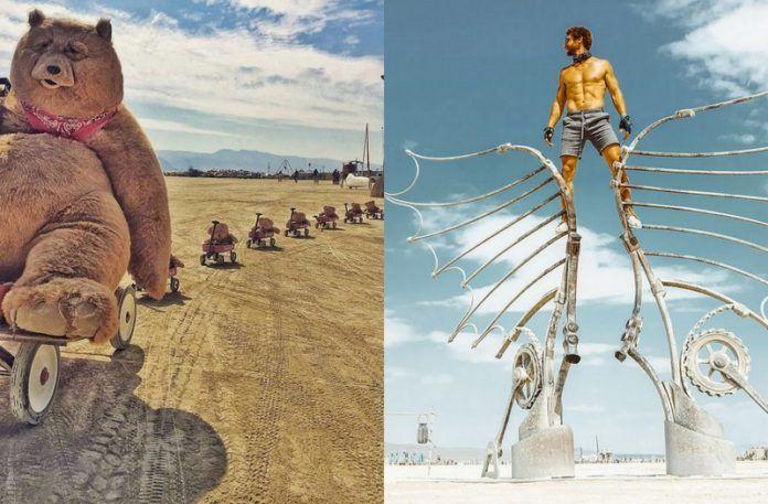 Niedźwiedź z wagonikami z małymi misiami i mężczyzna stojący na konstrukcji z żelaznych skrzydeł