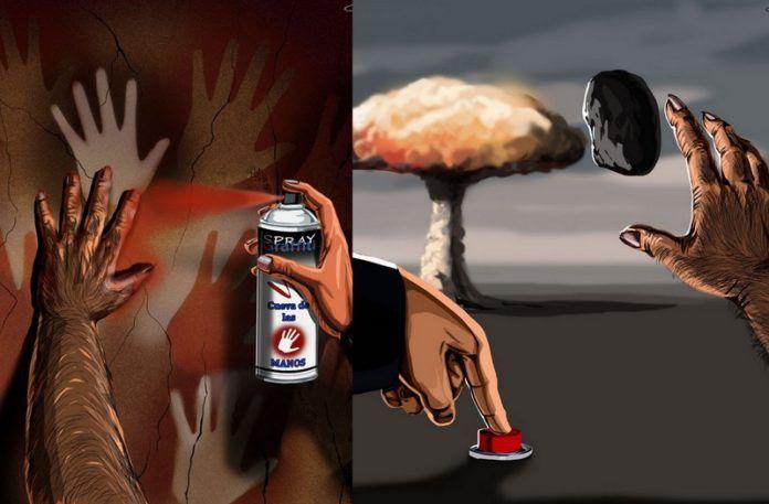 Rysunek przedstawiający ludzką rękę z puszką sprayu, kamieniem i przyciskiem detonującym