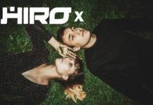 Dziewczyna z chłopakiem leżąca na trawie i logotyp HIRO