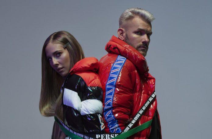 Chłopak i dziewczyna w zimowych kurtkach, związani pasami