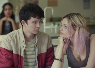 Dziewczyna w różowych włosach siedząca z chłopakiem