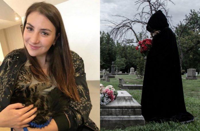 Dziewczyna z kotem i czarna postać stojąca przy grobie