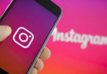 Telefon z logotypem Instagrama i napisem Instagram w tle