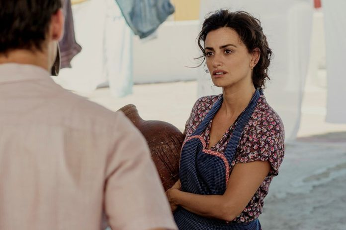 Kobieta w fartuszku kuchennym rozmawiająca z mężczyzną