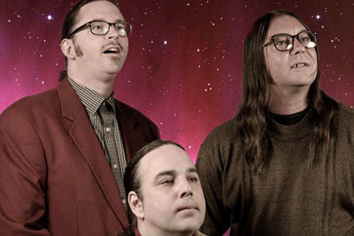 Trzech mężczyzn na czerwonym tle