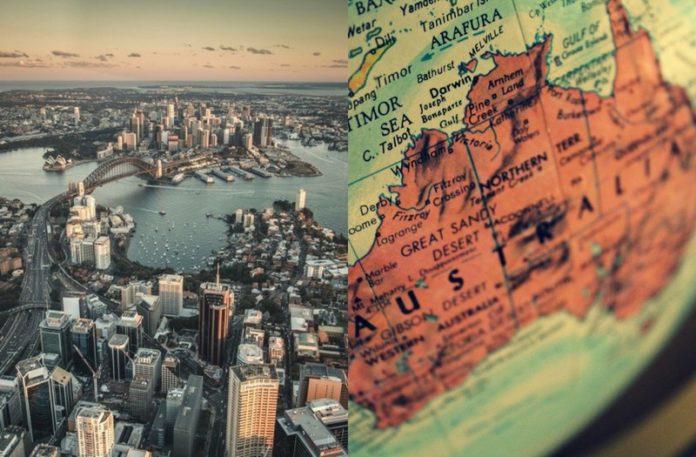 Zdjęcie przedstawiające mapę Sydney i globus z Australią
