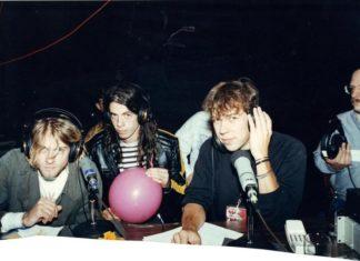 Analogowe zdjęcie pokazujące trzech mężczyzn