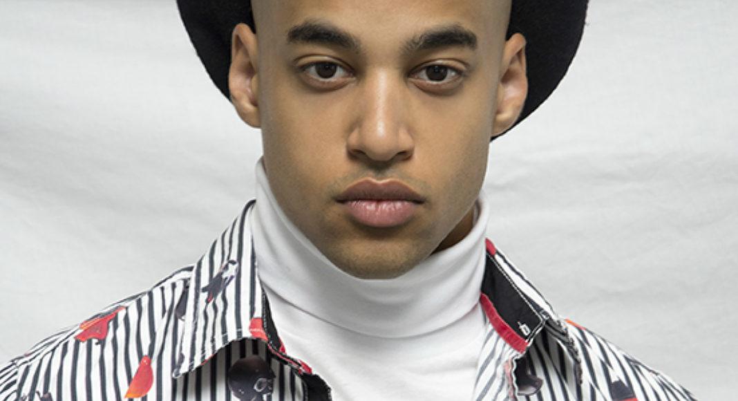 Portret ciemnoskórego mężczyzny w kapeluszu