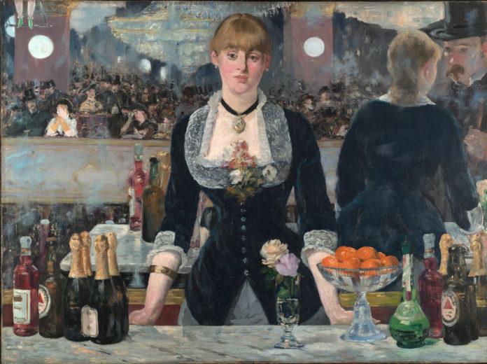 Kobieta stojąca za barem