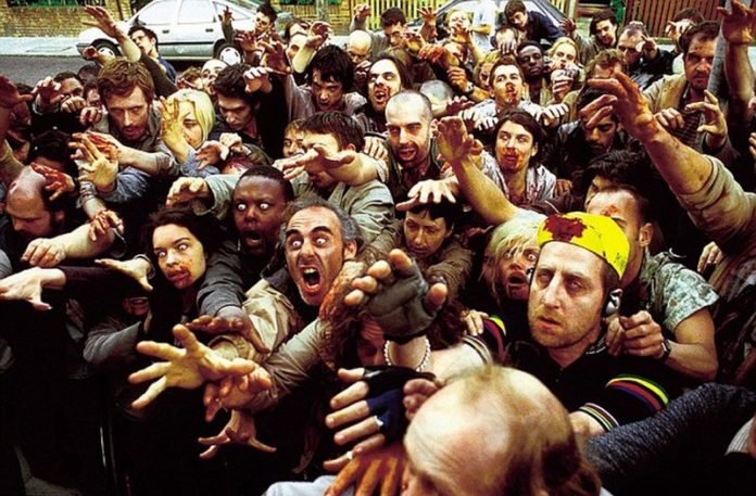 Tłum zombie wyciągających ręce