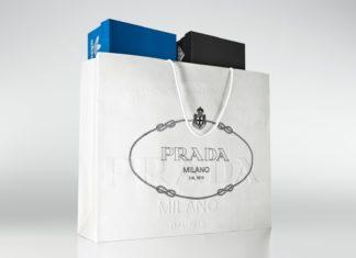 Biaa torba marki Prada z dwoma pudekami na buty marki Adidas w srodku