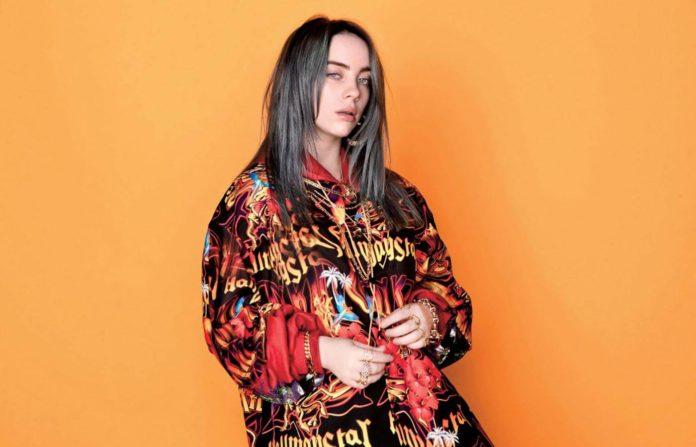 Piosenkarak Billie Eilish na pomarańczowym tle