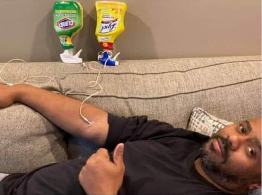 Mężczyzna ze środkami dezynfekującymi Antyszczepionkowcy